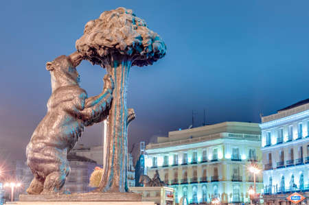 Statue of the Bear and the Strawberry Tree (Oso y el Madrono), sculpture which represents the heraldic arms of the city, installed on Puerta del Sol Square in Madrid, Spain. Editorial