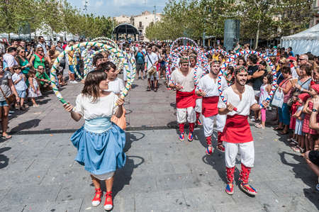 festividad: VILAFRANCA DEL PENEDES, SPAIN - AUG 29: Ball de Cercolets dance on Cercavila performance within the Festa Major celebrations Aug 29, 2012 in Vilafranca del Penedes, Spain.