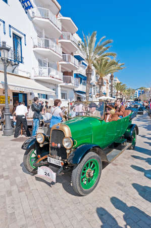 motorcar: SITGES, SPAIN - MARCH 11: Antoni Closas drives a 1918 Fiat on the second phase of the 54th Rally of Ancient Cars Barcelona-Sitges on March 11, 2012 in Sitges, Spain.