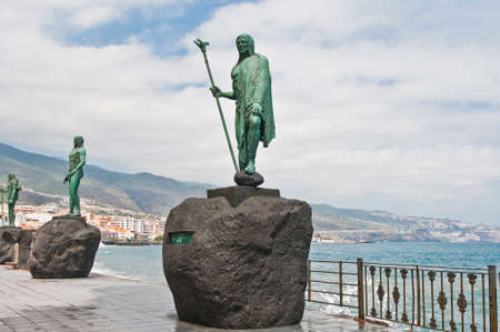 dominant color: Guanches indians statues located at Plaza de la Patrona de Canarias at Candelaria, Tenerife Island