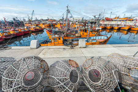 coastal city: Typical orange fishing boats on the port of the coastal city of Mar del Plata in Buenos Aires province, Argentina Editorial