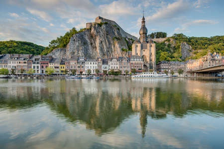 meuse: DINANT, BELGIUM – JUNE 15, 2014: The Meuse River passing through the town of Dinant, located in the Walloon, Belgium.