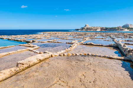 evaporation: Salt evaporation ponds, also called salterns or salt pans located near Qbajjar on the maltese Island of Gozo. Stock Photo