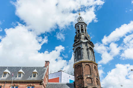 The Munttoren (Mint Tower) Muntplein square, where the Amstel river and the Singel canal meet, near the flower market and the end of Kalverstraat shopping street in Amsterdam, Netherlands.