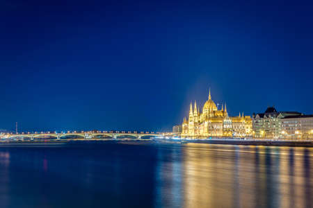 Hungarian Parliament Building (Orszaghaz) a notable landmark of Hungary and a popular tourist destination of Budapest. Фото со стока - 128310448