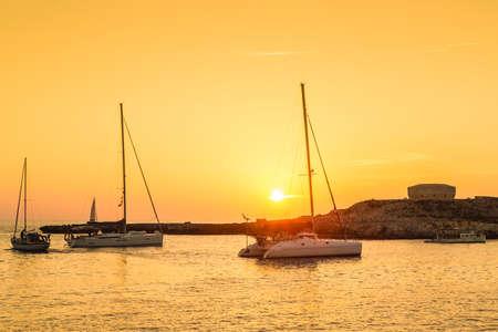 Sunset in Torre des Castellar (Santandria Tower) in Minorca island western shore, Balearic Islands, Spain.