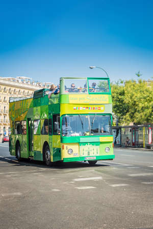 SEVILLE, ES - JULY 30, 2017: Touristic bus along the streets of Seville in Andalusia, Spain