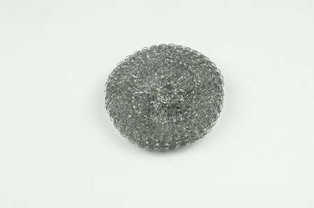 scrubber: Kitchen dish scrubber - studio photography of metal wire mesh scrubber Stock Photo