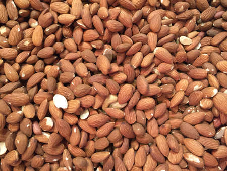 Peeled almonds closeup photo