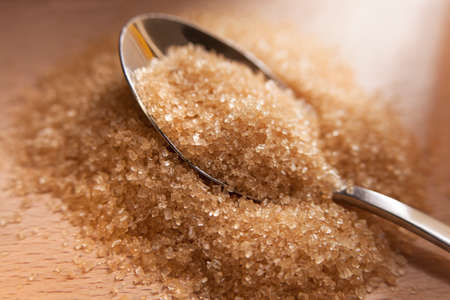 Healthy cane sugar on teaspoon Stock Photo - 16492769