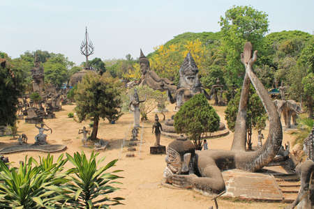 Group spellbinding sculptures in the Buddha Park near Vientiane Stock Photo