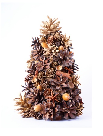 Christmas tree, decoration made from natural cones, cinnamon, spices  and acorns Stock Photo