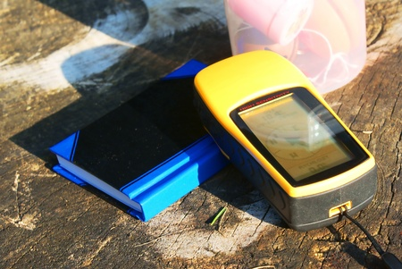 geocaching concept with geocache and GPS in nature