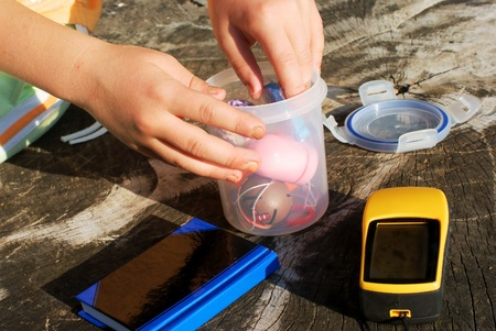 geocaching concept with geocache and GPS in nature photo