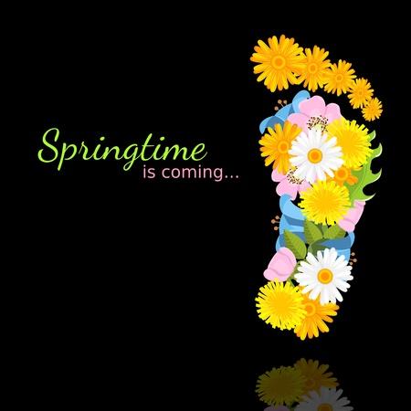 lentebloemen in de vorm van voetafdruk op een zwarte achtergrond met bezinning