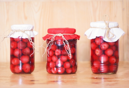 cherry compote in glass jar, studio shot