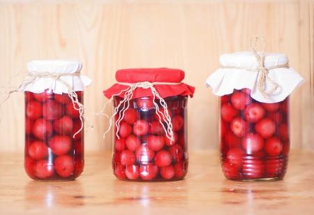 cherry compote in glass jar, studio shot