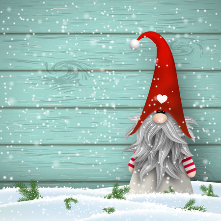 Nisser in Norway and Denmark, Tomtar in Sweden or Tonttu in Finnish, Scandinavian folklore elves, nordic christmas motive, Tomte standing in front of blue wooden wall in snow