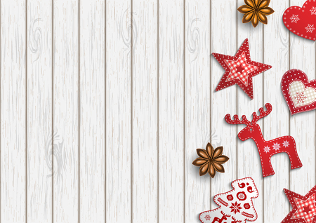 Christmas background, small scandinavian styled red decorations lying on white wooden desk, inspired by flat lay style