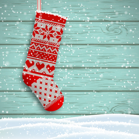 knit: knitted christmas stocking with red patterns on blue wooden background, vector illustration