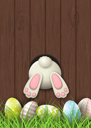 Easter motive, bunny bottom and easter eggs in fresh grass on brown wooden background, illustration Stok Fotoğraf - 74303172