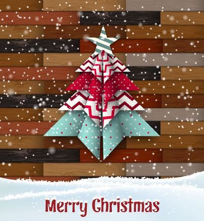 Abstract origami christmas tree on wooden background Stock Photo