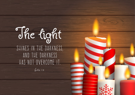 Group of Christmas candles with biblical quote
