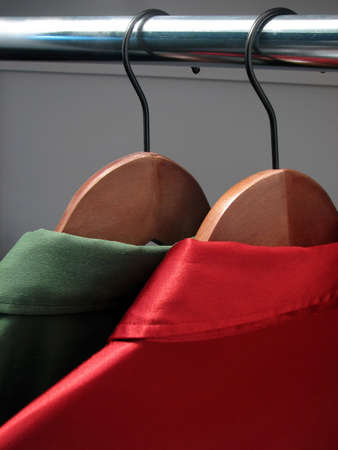 Red and green shirts on wooden hangers Stock Photo - 683234