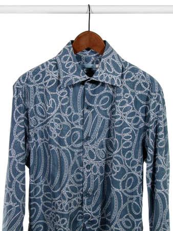 Stylish blue shirt on wooden hanger, isolated on white. photo