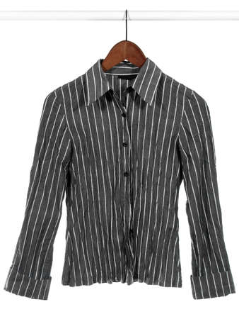 Stylish gray striped shirt on wooden hanger, isolated on white photo