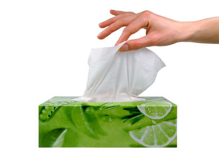 facial tissue: Delicate woman's hand pulls a tissue from a green tissue box.