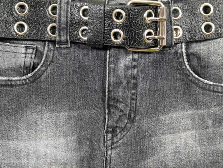 buckle: Closeup of black denim jeans with black leather belt and metal buckle. Stock Photo