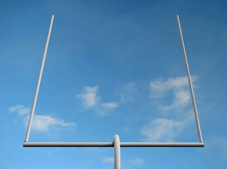 American football field goal posts against the blue sky.
