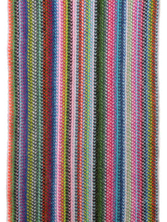 Textile background. Closeup of a vivid knitted scarf.