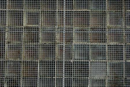 Rusty metal net covering the window. Stock Photo - 768788