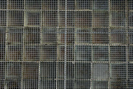 Rusty metal net covering the window. Stock Photo - 768788