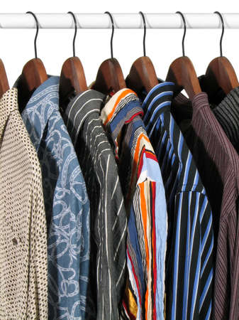 Choice of clothes of different colors in a closet. Isolated on white background. Stock Photo
