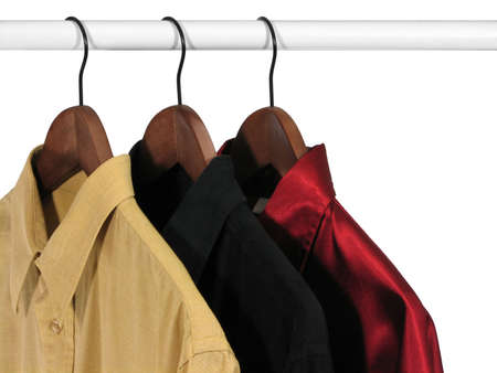 Yellow, black and red shirts on a rack, on white background. photo