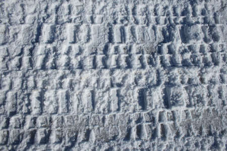 Tire tracks imprinted in snow. Stock Photo - 768781