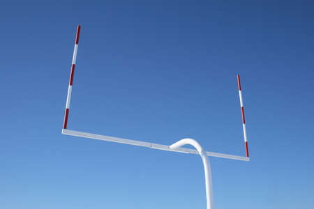 Uprights of American football goal posts against the blue sky. Stock Photo