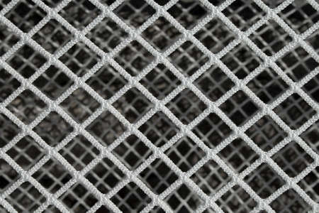 textured backgrounds: New hockey goal net, forming a symmetric pattern. Stock Photo