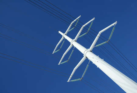 White high voltage electricity pylon and power lines against the deep blue sky. Stock Photo - 796290