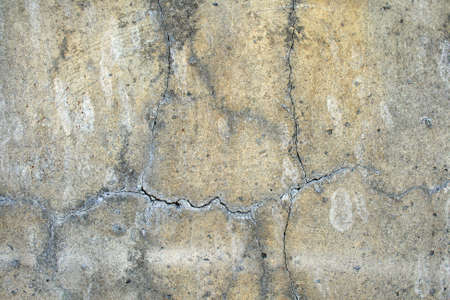 Grunge urban background: cracked and damaged concrete wall