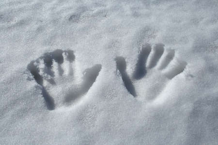 handprints: Winter theme: two handprints in the snow.