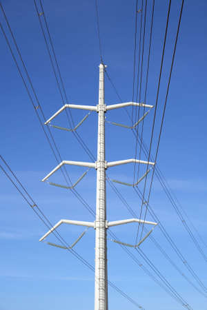 White high voltage electricity pylon and power lines against the blue sky. Stock Photo - 796320