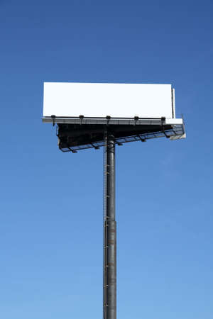 Blank billboard with copy space against the blue sky. photo