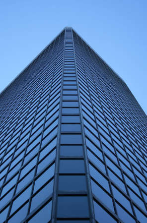 Angle view of a glass-windowed skyscraper photo