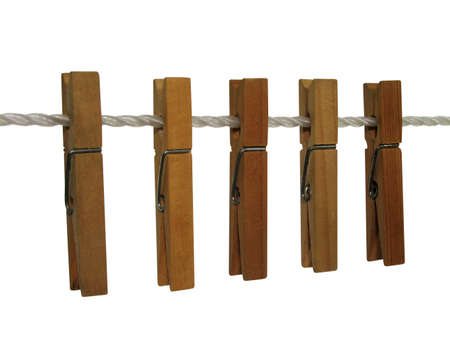 clothespins: Wooden clothespins on a clothes line, isolated on white. Contains clipping path.