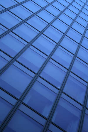 diagonal: Blue windows of a skyscraper, forming a diagonal pattern. Stock Photo