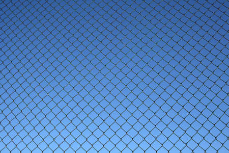rusty chain: Chain link fence, a bit old and rusty, on a blue sky background.